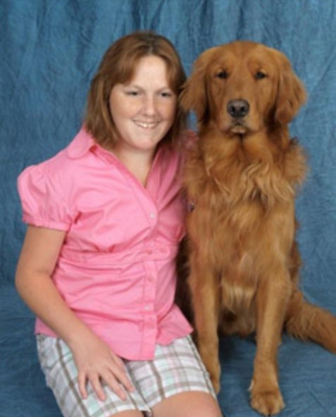 Photo of Ashley, and her guide dog Landon